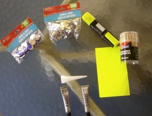 from l to r: rhinestones, highlighter to draw pattern, toothpicks and card to help apply glue, E6000 glue with nozzle